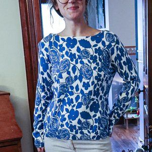 Artsy white and blue rose floral print sweater.
